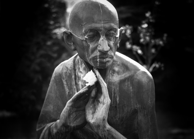 Gandhi & The Rose. May Day, Moscow, Russia 2015. I found Mahatma Gandhi in bronze near Gorki Park. I always wonder how those icons so focused on peace, civil rights and freedom... who have passed, would choose to hold the rose.