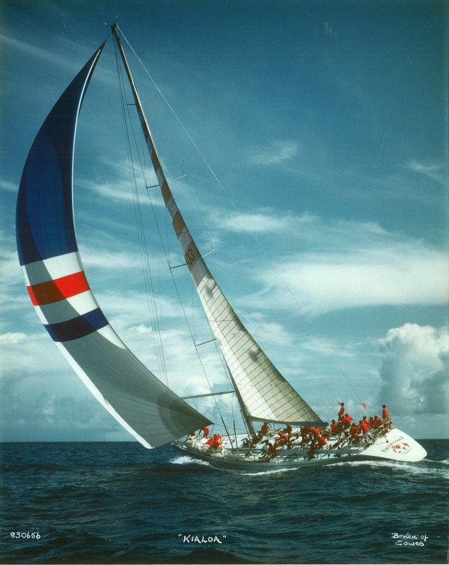 Hard pressed, Just look at the quarter wave! You don't see that in modern designs, thankfully. I think that is me at the mast, I would have just helped bounce the spin halyard and would have been putting the jockey pole up. This image is from Beken of Cowes.
