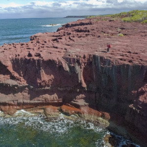 Multi-coloured rocks along the coastline.