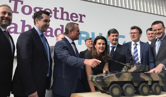 RUAG and BAE executives and Goldstein MP Tim Wilson look at a AMV35 model at RUAG's facility in Bayswater. Credit: BAE Systems Australia