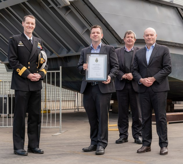 Sydney City Marine team and CDRE Colin Dagg, CSC, RAN - Director General Engineering – Navy at the signing ceremony for SCM achieving ADF docking certification.