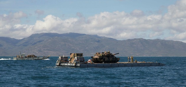 HMAS Choules' MEXEFLOTE landing raft transports an Abrams M1A1 main battle tank during Exercise Talisman Saber. Credit: Defence