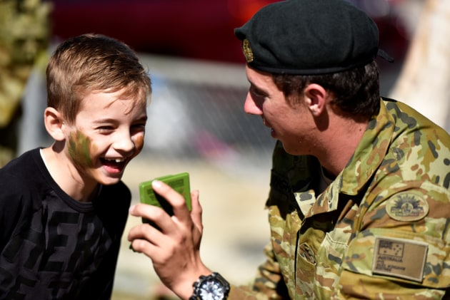 Members of the ADF at a local community event in Bowen, Queensland. 480,000 Queenslanders have a connection to Defence. 