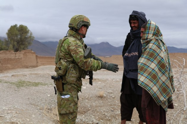 Brigadier John Shanahan speaks with Afghan people in Ghorak, Afghanistan.