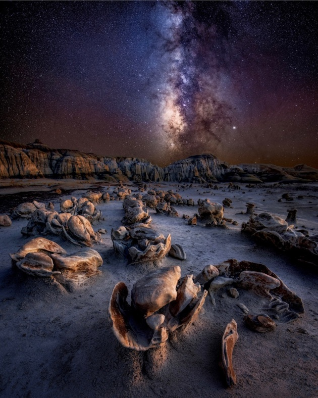 """Alien Eggs"" – Debbie Heyer. Badlands of New Mexico, USA. The Badlands of New Mexico are otherworldly and mysterious. They resemble an alien planet. If you don't believe in aliens, you will after seeing this place. This is not an easy terrain to navigate, and it is very easy to get lost. Luckily, my friends knew the area well, and we could enjoy this photographer's paradise of endless compositions that blew my mind! This was shot last October on a two-week photo tour with friends through the Southwest. It was the best way to end the Milky Way season."