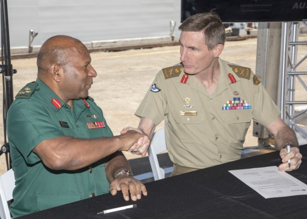 CDF Gen Angus Campbell and Papua New Guinea CDF Major General Gilbert Toropo signing the certificate of transfer.