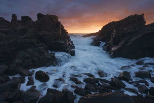 Bombo Sunrise: With messy seaweed littering the higher boulders, I used this as an opportunity to rethink the scene and move closer to the waterline. I snapped this wide-angle shot of the waves snaking back out to sea. Sony A7R Mark III, Sony 16-35mm f/2.8 lens @ 16mm. 1/4s @ f13, ISO 100.