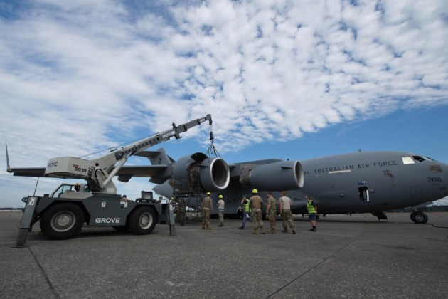 62nd Maintenance Squadron airmen and RAAF airmen work together to repair a RAAF C-17A Globemaster at Joint Base Lewis-McChord, Washington.