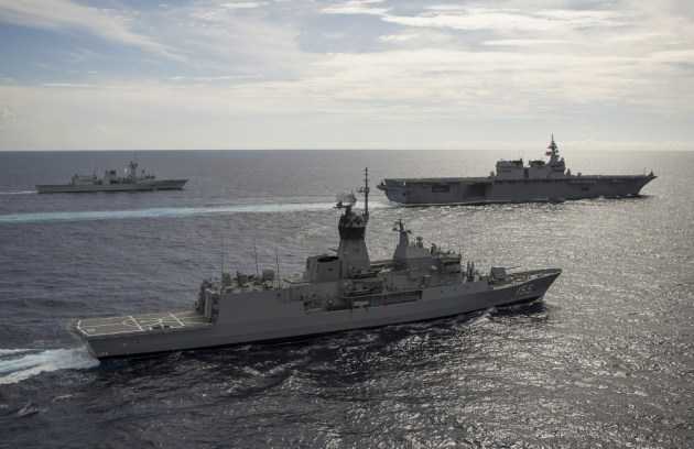 HMAS Ballarat sails in formation with the Canadian Navy's HMCS Winnipeg and the Japanese Navy's JS Izumo in the South China Sea.