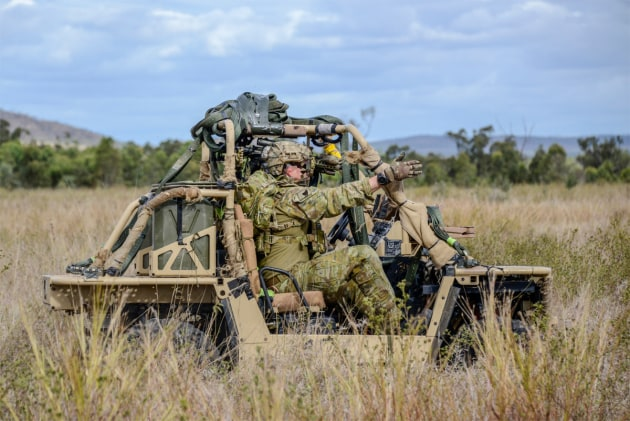 Soldiers from 2nd Commando Regiment drive their all-terrain vehicle near Townsville during Exercise Talisman Sabre.