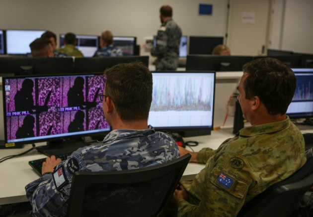 Members of No. 462 Squadron partake in Exercise Pink Pill - a Defensive Cyberspace Exercise.