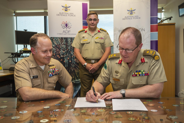 MAJGEN Marcus Thompson, the head of information warfare, signs a cyber training agreement between the US and Australia.