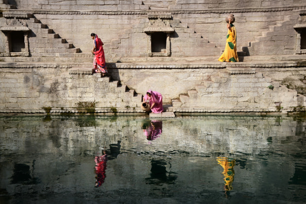 Ladies at Stepwell - This photo is an example of organising people to create interesting patterns in a scene for an aesthetically engaging result. The step wells in Rajasthan, India are used to get water from deep in the ground, and I have recreated the activity of collecting water with locals and given them some direction. The result is a photo that people can enjoy on a visual level while learning about a unique cultural practice done for centuries in the desert regions of India. (1/1250, f/6.3, ISO 320)