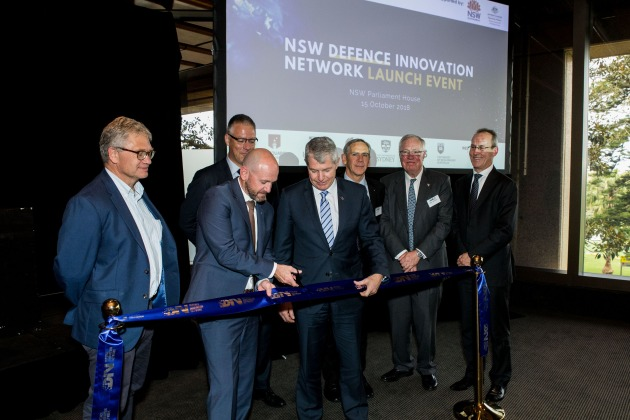 Professor Hugh Durrant-Whyte, Dr David Kershaw, Minister Blair, Senator David Fawcett, Air Marshal (retd) John Harvey, William Hutchinson, CMDR Peter Scott opening the DIN.