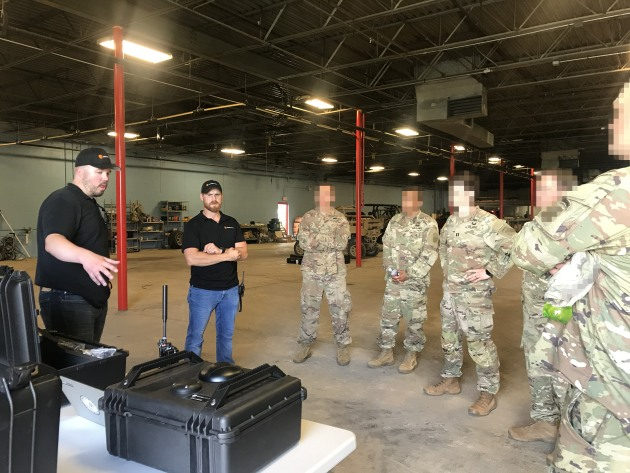Company representatives running a demo for the USAF.