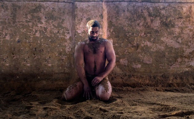As one of the akhara's most decorated athletes, I wanted to capture this wrestler as he cooled down on the kushti floor (mud wrestling pitch). I sat down opposite him on the mud as he threw mud over his body as I wanted to capture the quieter and reflective moments of this tough sport. Fuji X-Pro2, 16-55mm f/2.8 lens @ 25mm. 1/160s @ f4.5, ISO 1000.