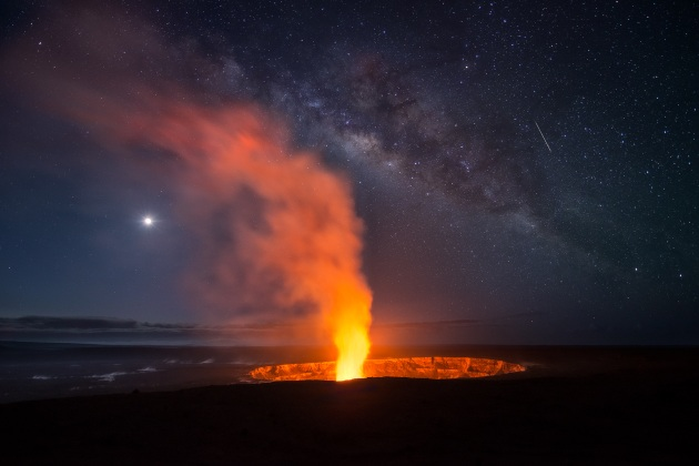 """Elemental"" – Miles Morgan. Kilauea Volcano, Hawaii – USA. During my trip to Hawaii, we were typically up around 2:30 am, and playing all day and well past sunset out on the lava flows. On this particular evening, after shooting the sunset, we checked Stargazer and saw that around 3-4 am, many of the planetary elements would be aligning around the plume at the Halema'uma'u crater. Even though the skies were covered during most of the night, we happened to be at the right time to capture the lava and the Milky Way"