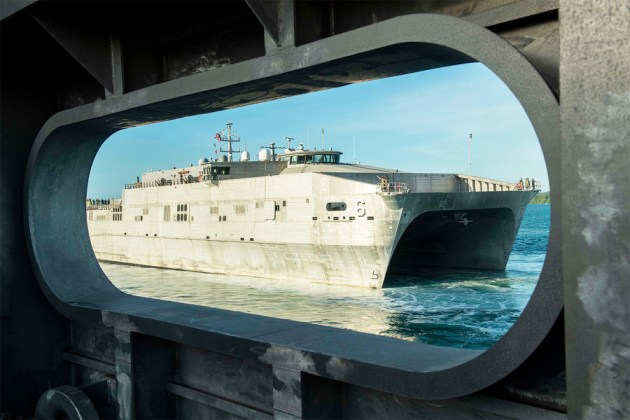 The expeditionary fast transport ship USNS Brunswick departs Naval Base Guam. US DoD