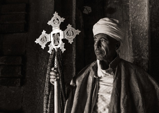 A priest inside one of the rock-hewn churches of Lalibela in Ethiopia. This B+W conversion in Lightroom is relatively out-of-the-box but with extra Clarity applied to the cross to make the reflections stand out more. LEICA SL (Typ 601), Super-Elmar-M 18mm f/3.8 ASPH lens. 1/30s @ f3.8, ISO 3200. -2EV.