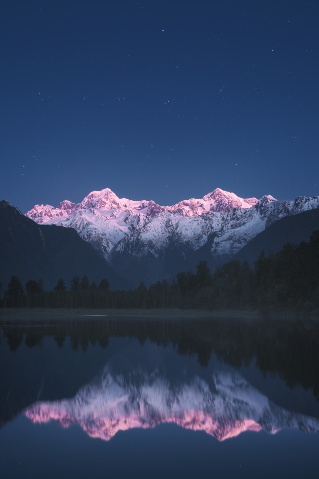 Looking across Lake Matheson, New Zealand, this image is a blend of two exposures – one taken after sunset for the alpenglow and the other an hour after to capture the stars. Shifting the alpenglow away from warmer reds to more of a magenta helped to complement the cool twilight lighting. Sony A7R Mark II, FE 55mm F1.8 ZA lens. 4s @ f2.5, ISO 2500.