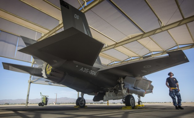 Corporal Cory Cochrane inspects an Australian F-35A on the flight line at Luke Air Force Base.