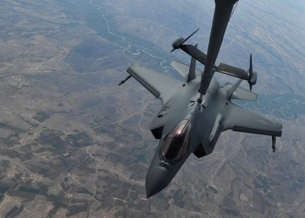 A USAF KC-10 Extender refuels an F-35A fitted with external missiles on the day of the strike.