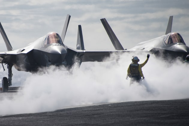Sailors direct an F-35C Lightning II on the flight deck of the aircraft carrier USS Carl Vinson.