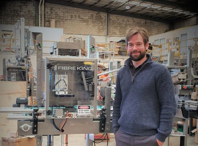 James Windsor, Fibre King CEO, stands next to the new PakTech CCA for craft breweries.