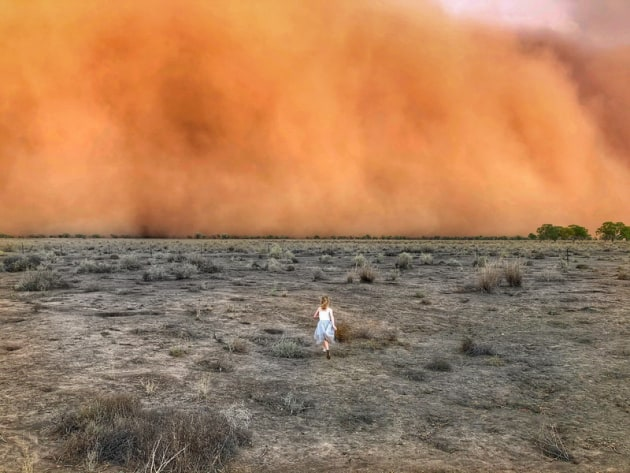 2020 Landscape Prize - Overall winner. © Marcia Macmillan. Whimsical warrior. Macmillan, who caught the moment her daughter, a quintessential farm girl who likes to dress up, ran towards a huge dust storm. A fragile, yet fearless nine-year-old, challenging mother nature to unleash herself in all her fury.