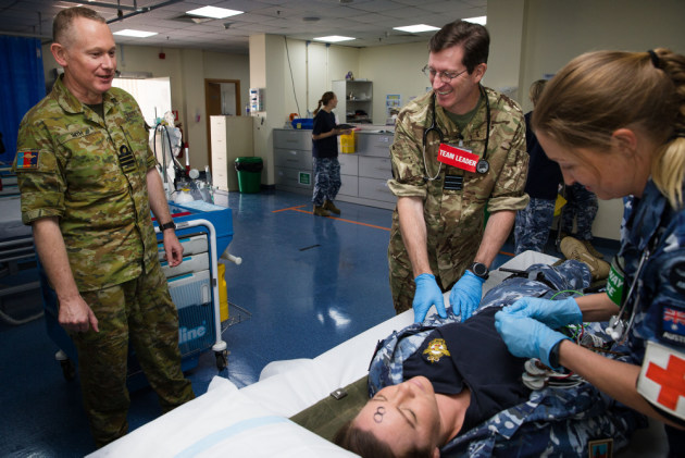 Commander Neil Smith, of Navy Health Services, monitors a mass casualty exercise at the Camp Baird Role 1 Medical Facility. Defence