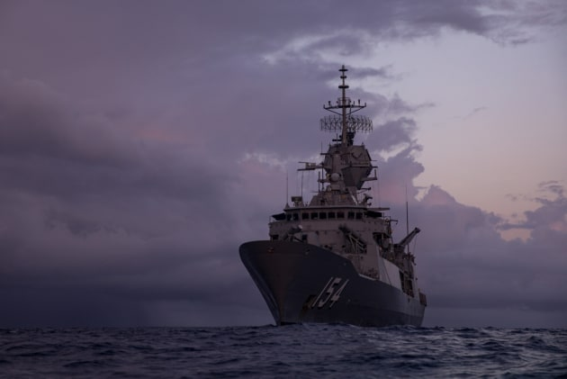 HMAS Parramatta during training exercises on the Coral Sea at dawn.