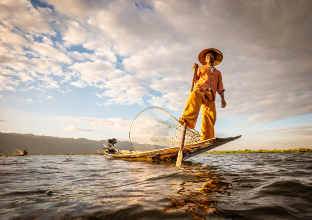 Inle Lake, Myanmar. I used a very wide angle lens and shot from mere inches above the water to lift the fisherman above the horizon so he stood out against the interesting clouds. LEICA SL (Typ 601), Super-Elmar-M 1:3.8/18 ASPH lens. 1/400s @ f4, ISO 100.
