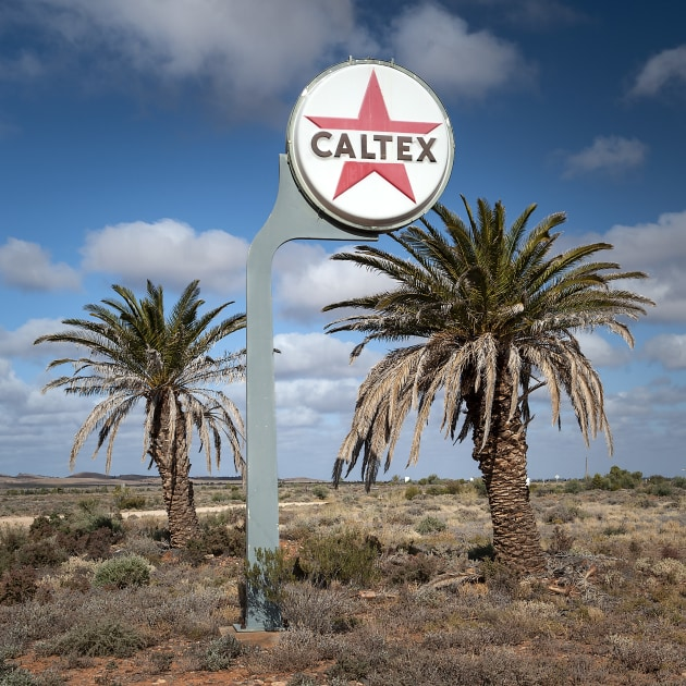 This photo was made near an old roadhouse in South Australia. We can tell it was sunny because we can see hard shadows around the bottom edge of the Caltex sign. If we look closer we can also see a hint of shadow at the base of the sign and the palm trees, and this tells us the sun was almost directly behind the camera position. Nikon D3, 24-70mm f/2.8 lens @ 45mm. 1/500s @ f11, ISO 400.