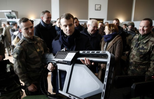 French President Emmanuel Macron handles the DroneGun Tactical during a visit to French Army Camp Mourmelon. Credit: DroneShield