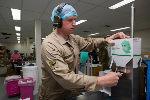 Corporal Sander Vloothuis operates surgical face mask machine.