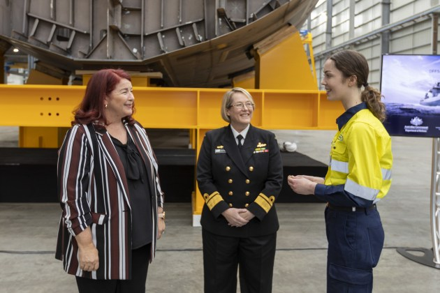 Minister for Defence Industry Melissa Price and Head of Maritime Systems, Rear Admiral Wendy Malcolm speak with Apprentice Hayley Maisey at the Civmec facility in Henderson.