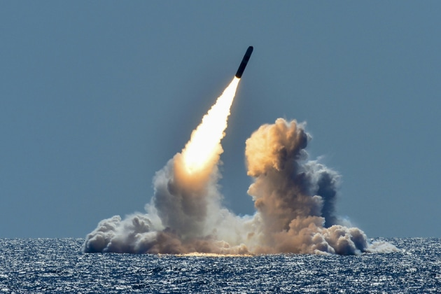 An unarmed Trident II D5 missile launches from the ballistic missile submarine USS Nebraska in the Pacific Ocean. US DOD