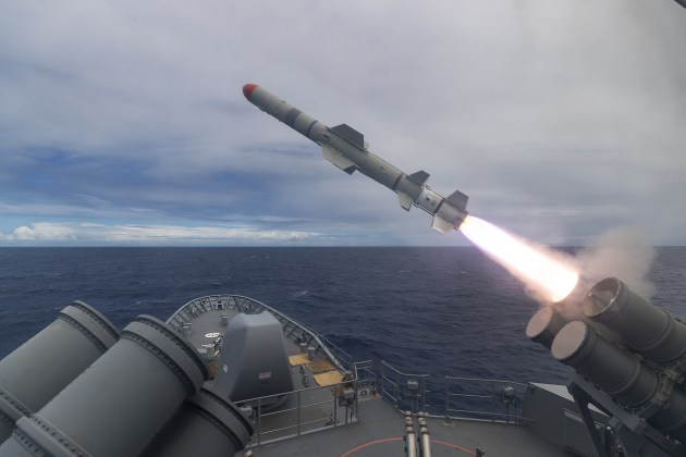 An Australian warship firing a live Harpoon Missile firing off the coast of Hawaii during Exercise Rim of the Pacific 2020.