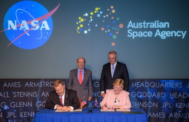 U.S. Secretary of Commerce Wilbur Ross and Australian Prime Minister Scott Morrison witness the signing of a letter of intent between NASA and the Australian Space Agency by NASA Deputy Administrator Jim Morhard, left, and Dr. Megan Clark AC, Head of the Australian Space Agency, right, at NASA Headquarters in Washington. Credit: (NASA/Joel Kowsky)