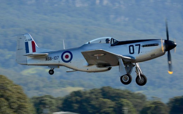 The CAC Mustang departs to catch up with the fighter formation. (Steve Hitchen)