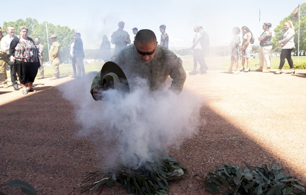 Corporal John McBeth participates in the smoking ceremony during the launch of 2020 NAIDOC Week at Russell Offices, Canberra.