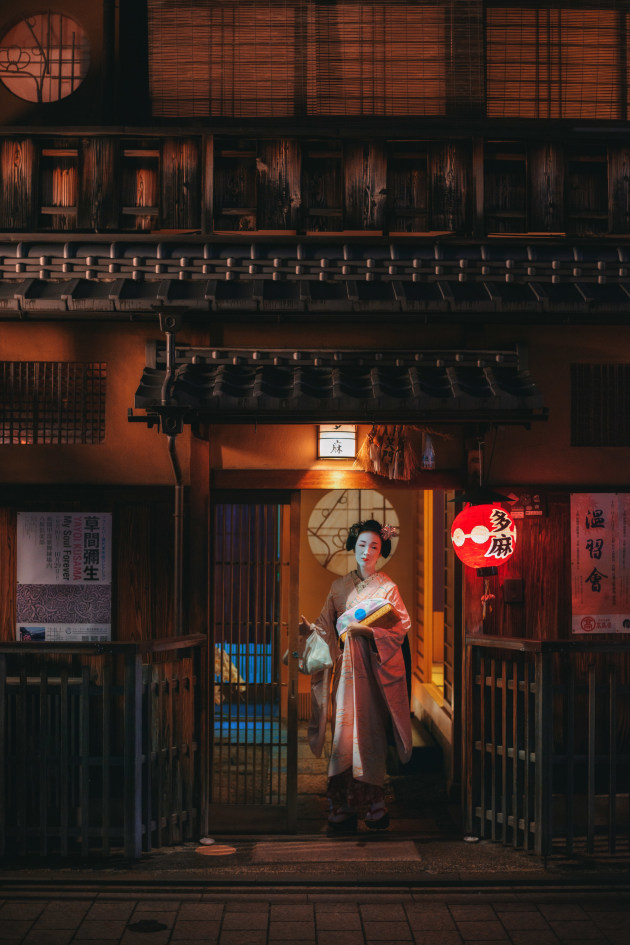 Kyoto, Japan. Trying to photograph the Geisha in Kyoto can be a challenging experience. Not wanting to be yet another rude tourist thrusting a camera right into a poor girls face, I opted instead to hang back and try to incorporate the architecture of the old streets of Gion into any opportunities I had to photograph any chance Geisha sightings. Luckily I caught this a split second before my framing was filled with hordes of other tourists wielding selfie sticks! Yikes! Nikon D810, 50mm lens. 1/160s @ f2, ISO 1600.