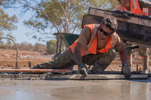 Sapper Collin Bowley of 6th Engineer Support Regiment, constructing an all-weather creek crossings on the outskirts of Jigalong Community.