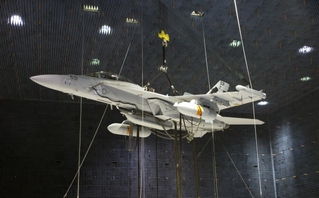 Two Next Generation Jammer Mid-Band pods, attached to an EA-18G Growler, undergo testing in the anechoic chamber.