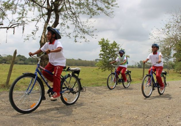 Bicycles let students get to school about four times faster than walking, even on rough dirt roads.