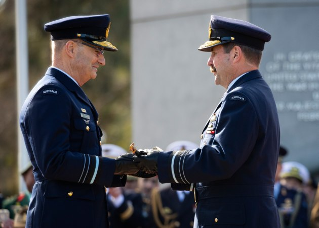 Air Marshal Leo Davies presents Air Marshal Mel Hupfeld with Sir Richard Williams' sword during the ceremonial parade.