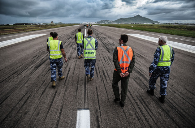Aerodrome Reporting Officer course participants walk the cross strip of RAAF Base Townsville.