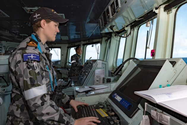 Officer of the Watch Lieutenant Ann Carroll navigates HMAS Ballarat towards a distress beacon during a search and rescue operation. Defence