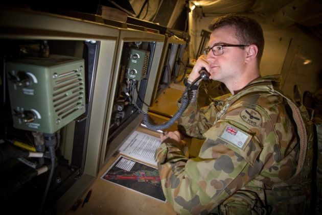 Aircraftman Brendan Greenwood monitors the Base Radio Communications Device at Williamson Airfield.