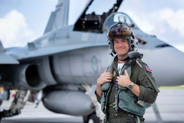 Royal Air Force exchange pilot, Flight Lieutenant Joseph Murphy stands in front of a RAAF F/A-18A Hornet.